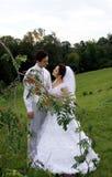 Wedding. Young happy newlyweds couple outdoors stock images