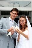 Wedding. Happy young newlyweds couple outdoors stock photo