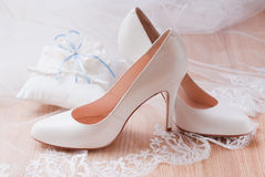 Wedding accessories. Luxury ivory wedding accessories for bride, selective focus Stock Image