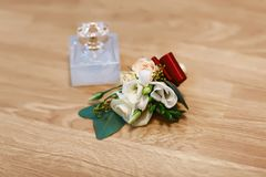 Wedding accessories, bouquet and perfume bridal and bridal accessories, wedding details on a wooden background.  Stock Photo