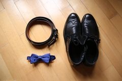 Wedding accessories: bow tie and  leather shoes. On wood background Stock Images