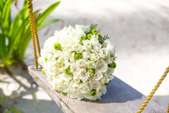 Wedding accessories. The bride's bouquet on a tropical beach. Royalty Free Stock Photos