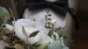 Wedding accessories butterfly and bouquet of flowers. boutonniere and tie