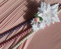 Wedding accessories:  buttonhole and a string of pearls Royalty Free Stock Image