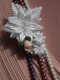 Wedding accessories:  buttonhole and a string of pearls Royalty Free Stock Images