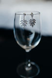 Wedding accessories earrings on the glass Stock Photography