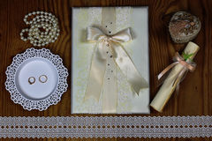 Wedding accessories and invitations to frame light wooden table Stock Photo