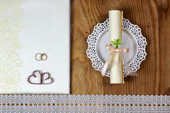 Wedding accessories and invitations to frame light wooden table Royalty Free Stock Photography