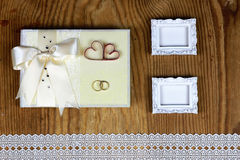 Wedding accessories and invitations to frame light wooden table Royalty Free Stock Image