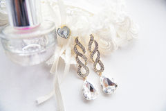 Wedding accessories, perfume and earrings Stock Photo
