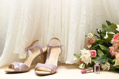 Wedding accessories, shoes and rose bouquet on wooden floor Royalty Free Stock Images