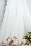 Wedding accessories, shoes and rose bouquet on wooden floor Stock Images