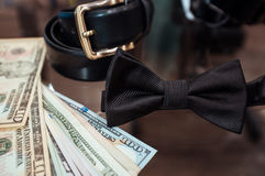 Wedding accessories in shop and dollars. Wedding accessories for the groom (a belt and a tie) in shop of fashionable men's wear and dollars Stock Photo