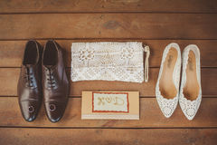 Wedding accessories, wedding shoes. On a brown wooden background Stock Images