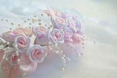Wedding accessory. Pink and white artificial flowers. Color-processed stock image