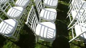 Wedding aisle decor. White wedding chairs. Outdoor stock video footage