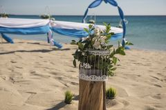 Wedding aisle setup on tropical beach. Setup of wedding day marriage aisle with drapes and arch on sandy tropical beach paradise to open ocean background stock photos