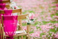 Wedding aisle for a tropical destination wedding. White Dendrobium Orchid and Pink Ginger flower on a wedding aisle for a destination wedding Royalty Free Stock Image