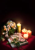 Wedding album for guests among flowers and candles Stock Photos