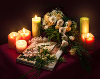 Wedding album for guests among flowers and candles Stock Photography