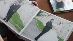 Wedding album. Newlyweds looking at their wedding photo album