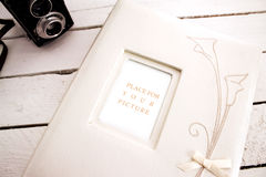 Wedding album with old camera Royalty Free Stock Photo