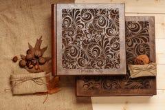 Wedding album on wooden background Royalty Free Stock Photography