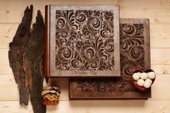 Wedding album on wooden background Stock Images