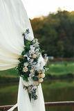 Wedding altar decorated with white and cream colored floweres Royalty Free Stock Photo