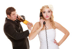 Wedding. Angry bride and groom talking on phone Stock Photo