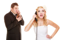 Wedding. Angry bride and groom talking on phone Stock Photos