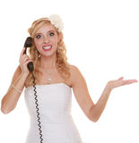 Wedding angry woman bride talking on phone. Stock Photo