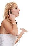 Wedding angry woman bride talking on phone. Royalty Free Stock Images