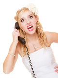 Wedding. Angry woman fury bride talking on phone. Wedding relationship difficulties. Angry woman talking on the phone. Fury bride screaming isolated on white stock photography