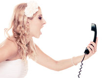 Wedding. Angry woman fury bride talking on phone Royalty Free Stock Photo