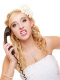 Wedding. Angry woman fury bride talking on phone Royalty Free Stock Photos