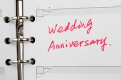 Wedding anniversary. Words written on notebook Royalty Free Stock Photo