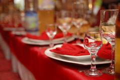 Wedding anniversary table detail. Wedding anniversary detail, glass in focus and the rest in a deep dof royalty free stock images