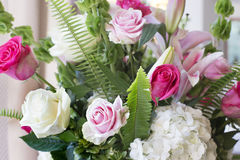 Wedding arangement from fresh cut flowers. Bouquet of flowers from pink, red, white roses, white hydrangea, fern, green leafs. this table decoration created for Royalty Free Stock Photography