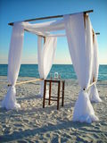Wedding arbor on beach. Wedding arbor structure and table on tropical beach, summer scene Royalty Free Stock Photo