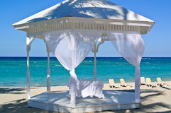 Wedding arbor by the sea. Gazebo for a wedding ceremony on the beach Stock Photos