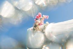 Wedding arc corner with sakura flowers in bright white bokeh blur. Close-up view.  Stock Image