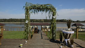 The wedding arc decorated with white butterflys. Which move from the wind stock video