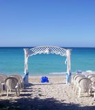 Wedding Arch. A white wedding arch decorated with white and blue ribbons on the beach in Varadero, Cuba Royalty Free Stock Images
