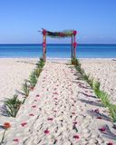 Wedding Arch. A wooden wedding arch decorated with burgundy flowers  on the beach in Varadero, Cuba Stock Photo