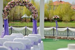 Wedding arch. Wedding arbor with a flower arch and white chairs Royalty Free Stock Photos