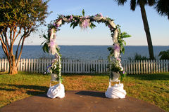 Wedding arch. Beautiful arrangement of flowers decorating a wedding ceremony arch outside Royalty Free Stock Photos