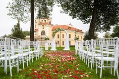 Wedding arch on the background of the castle stock photography