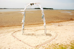 Wedding arch on beach. Wedding arch in heart shape on the sand of a beach Stock Image