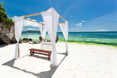 Wedding arch on beach. Wedding arch decorated on tropical beach Royalty Free Stock Photos